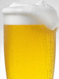 Pils with Head of Foam in Glass with Condensation Fotografie-Druck