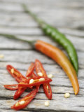 Chili Peppers, Whole and Sliced Photographic Print by Winfried Heinze