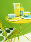 Bowls, Beakers and Coffee Pot on Yellow Metal Table Photographic Print by Benedetta Spinelli