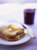 Two Slices of Toast with Butter and Strawberry Jam Photographic Print by Jonathan Syer