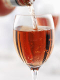 Pouring Rose Wine into Wine Glass Photographic Print by Joff Lee