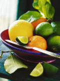 A Selection of Citrus Fruits in a Bowl Photographic Print