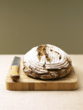 Bauernbrot (German Farm Bread) on Wooden Board with Knife Photographic Print by Jost Hiller