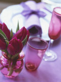 Red Tulips in Small Vase Beside Place Setting Photographic Print by Michael Paul