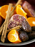 Mandarin Oranges, Dates, Pomegranate and Cinnamon Sticks Photographic Print by Ulrika Pousette
