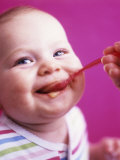 Baby Being Fed Baby Food Photographic Print by Alexandra Grablewski