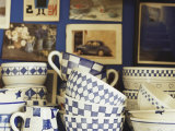 Blue and White Crockery in Front of Wall with Photographs Photographic Print by Michael Paul