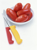 Plum Tomatoes in a Dish, Two Kitchen Knives Photographic Print by Peter Medilek