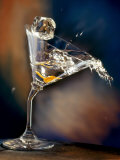 Vodka Martini Spilling from a Bent Martini Glass with Ice Cube Photographic Print by Jeff Sarpa