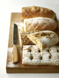 Assorted Loaves on Wooden Chopping Board Photographic Print by Michael Paul