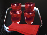 Water and Ice Cubes in Red Glasses on Tray Photographic Print by Michael Paul
