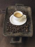 A Cup of Espresso on a Wooden Bowl with Coffee Beans Fotografie-Druck von Anita Oberhauser
