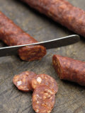Slicing Chorizo Photographic Print by Winfried Heinze