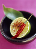 Still Life with Lime, Chili, Saffron and Kaffir Lime Leaf Photographic Print by Jean Cazals