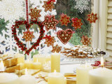Christmassy Window Decorated with Biscuits and Candles Photographic Print by Linda Burgess