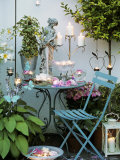Table with Candles and Roses on a Terrace Photographic Print by Elke Borkowski