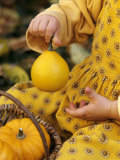 Girl Holding a Baby Pumpkin Photographic Print by Alena Hrbkova