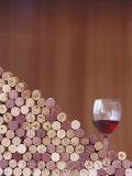 Wine Corks, Piled Up, and a Glass of Red Wine Photographic Print by Henrik Freek