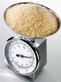 Brown Rice on Kitchen Scales Photographic Print