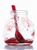 A Jar with Remains of Raspberry Jelly and Spoon Photographic Print by Marc O. Finley