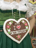 Woman in National Dress with Lebkuchen Heart at Oktoberfest Photographic Print