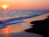 Coucher de soleil sur la plage Photographie