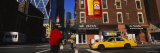 Yellow Taxi on the Road Intersection, Manhattan, New York City, New York, USA Photographic Print by  Panoramic Images