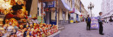 Senior Man Selling Russian Nesting Dolls in the Street, Arbat Street, Moscow, Russia Photographic Print by  Panoramic Images