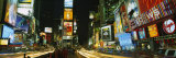 Neon Boards in a City Lit Up at Night, Times Square, New York City, New York, USA Photographic Print by  Panoramic Images