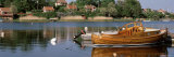 Boat Moored in a River, Sweden Photographic Print by  Panoramic Images