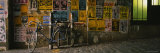 Bicycle Leaning Against a Wall with Posters in an Alley, Post Alley, Seattle, Washington, USA Photographic Print by  Panoramic Images