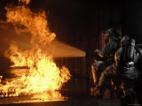 Firefighters Extinguishing a Simulated Battery Fire Photographic Print by  Stocktrek Images