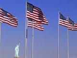 Statue of Liberty and Us Flags, New York City, USA Photographic Print by Walter Bibikow