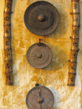 Gongs Hanging on a Wall, Vietnam Photographic Print by Peter Adams