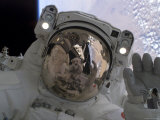 Astronaut Participates in Extravehicular Activity Photographic Print by  Stocktrek Images