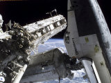 Space Shuttle Discovery Docked to the International Space Station Photographic Print by Stocktrek Images 