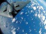 KC-135 Stratotanker Refuels B-2 Spirit Photographic Print by  Stocktrek Images