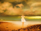 Glowing Woman Standing on the Beach Photographie par Jan Lakey