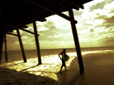 Surfer Walking along Tide Photographic Print by Jan Lakey