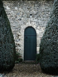 Stone Entry and Wood Door Flanked by Manicured Bushes Photographic Print by Tim Kahane