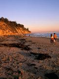 Couple Walking Down Henry's Beach, Santa Barbara, California Photographic Print by Savanah Stewart