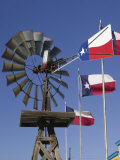 Old Water Pump and Texas State Flags, Amarillo, Texas Photographic Print by Walter Bibikow