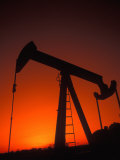 Silhouette of Oil Pump Jack, Tulsa, Oklahoma Photographic Print by Bill Bachmann