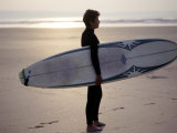 Surfer on a Beach, North Devon, England Photographie par Lauree Feldman
