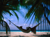 Woman in Hammock on Beach, Ari Atoll, Maldives Photographic Print by Stuart Westmorland