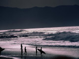 Surfers at Sunset, Ehukai, Oahu, Hawaii Photographic Print by Bill Romerhaus