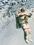 Astronaut Walking in Space Photographic Print by David Bases