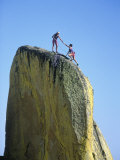 Rock Climber Helping Partner Onto Rock, Needle, CA Photographic Print by Greg Epperson