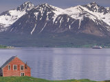 Small Farm Building with Mountains, Harstad, Norway Photographic Print by Walter Bibikow