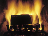 Log Burning in Fireplace Fotodruck von Chris Rogers